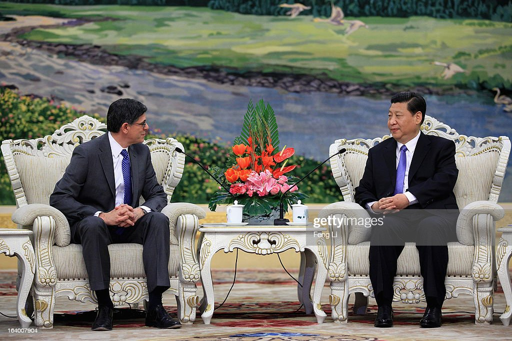 Chinese President Xi Jinping (R) speaks to U.S. Secretary of Treasury Jacob Lew during their meeting at the Great Hall of the People on March 19, 2013 in Beijing, China. Chinese leader Xi Jinping spoke of wanting strong ties with the U.S. after holding talks with the US Treasury secretary Jacob Lew today in his first meeting with a foreign official since being appointed as president.