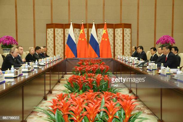 Chinese President Xi Jinping speaks with Russian President Vladimir Putin during a bilateral meeting at Diaoyutai State Guesthouse in Beijing China...