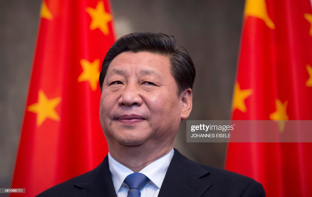 Chinese President <a gi-track='captionPersonalityLinkClicked' href=/galleries/search?phrase=Xi+Jinping&family=editorial&specificpeople=2598986 ng-click='$event.stopPropagation()'>Xi Jinping</a> stands by national flags at the Schloss Bellevue presidential residency in Berlin on March 28, 2014. Chinese President <a gi-track='captionPersonalityLinkClicked' href=/galleries/search?phrase=Xi+Jinping&family=editorial&specificpeople=2598986 ng-click='$event.stopPropagation()'>Xi Jinping</a> begins a landmark visit to fellow export powerhouse Germany Friday, the third leg of his European tour, expected to cement flourishing trade ties and focus on the Crimea crisis. EISELE