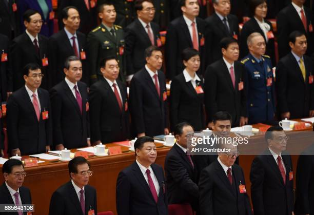 Chinese President Xi Jinping stands with former presidents Hu Jintao and Jiang Zemin Premier Li Keqiang and National People's Congress Chairman Zhang...
