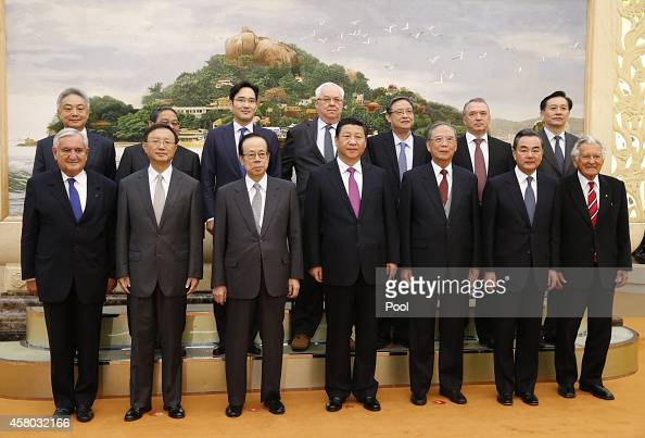 Chinese President Xi Jinping takes a photos with members of Board of Directors of the Boao Asia Forum at the Great Hall of the People on October 29...