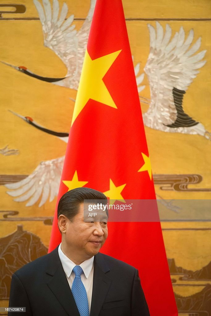 Chinese President Xi Jinping takes part in a signing contracts ceremony with his French counterpart Francois Hollande (unseen) as part of a two-day visit of State at the Great Hall of the People in Beijing on April 25, 2013.