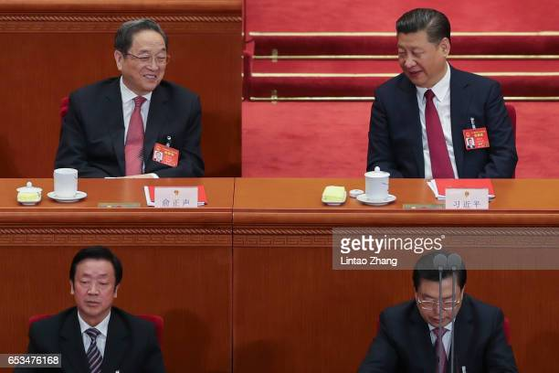 Chinese President Xi Jinping talk with Chairman of the National Committee of the Chinese People's Political Consultative Conference Yu Zhengsheng...