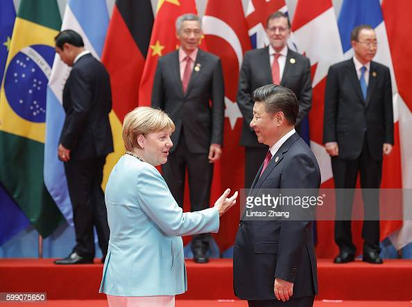Chinese President Xi Jinping talk with German Chancellor Angela Merkel to the G20 Summit on September 4 2016 in Hangzhou China World leaders are...