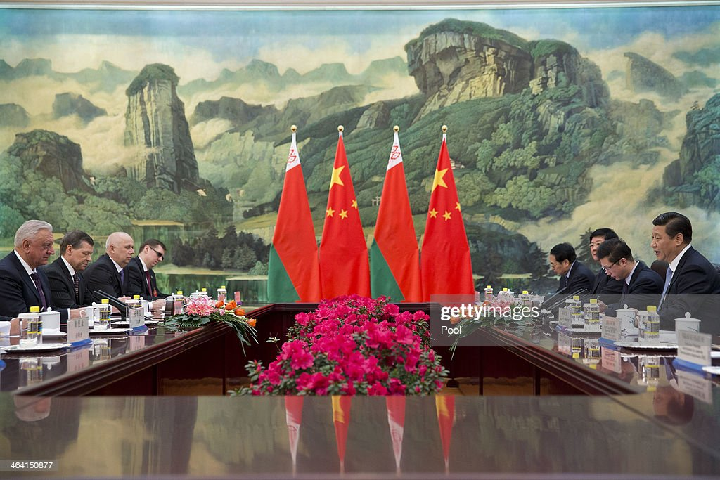 Chinese President <a gi-track='captionPersonalityLinkClicked' href=/galleries/search?phrase=Xi+Jinping&family=editorial&specificpeople=2598986 ng-click='$event.stopPropagation()'>Xi Jinping</a> (R) talks to Prime Minister of Belarus Mikhail Myasnikovich (L) during their meeting at the Great Hall of the People on January 21, 2013 in Beijing, China,