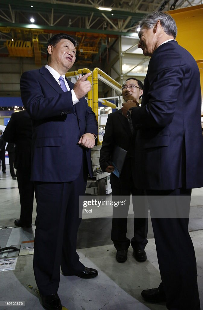 Chinese President Xi Jinping talks to Ray Conner president and CEO Boeing Commercial Airplanes during a tour the Boeing assembly line on September 23...
