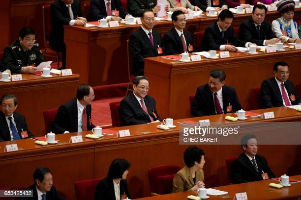Chinese President Xi Jinping talks to Yu Zhengsheng Chairman of the National Committee of the Chinese People's Political Consultative Conference and...