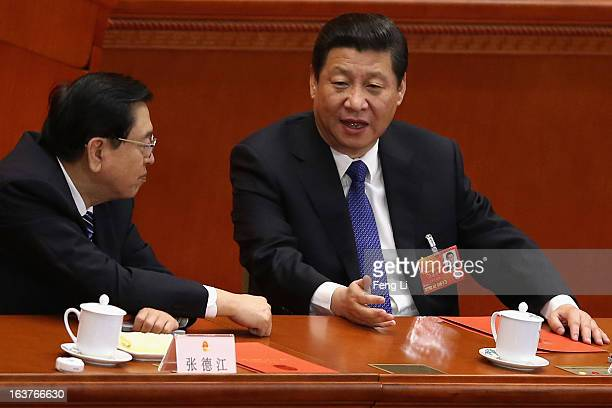 Chinese President Xi Jinping talks with Chairman of the National People's Congress Zhang Dejiang during the fifth plenary meeting of the National...