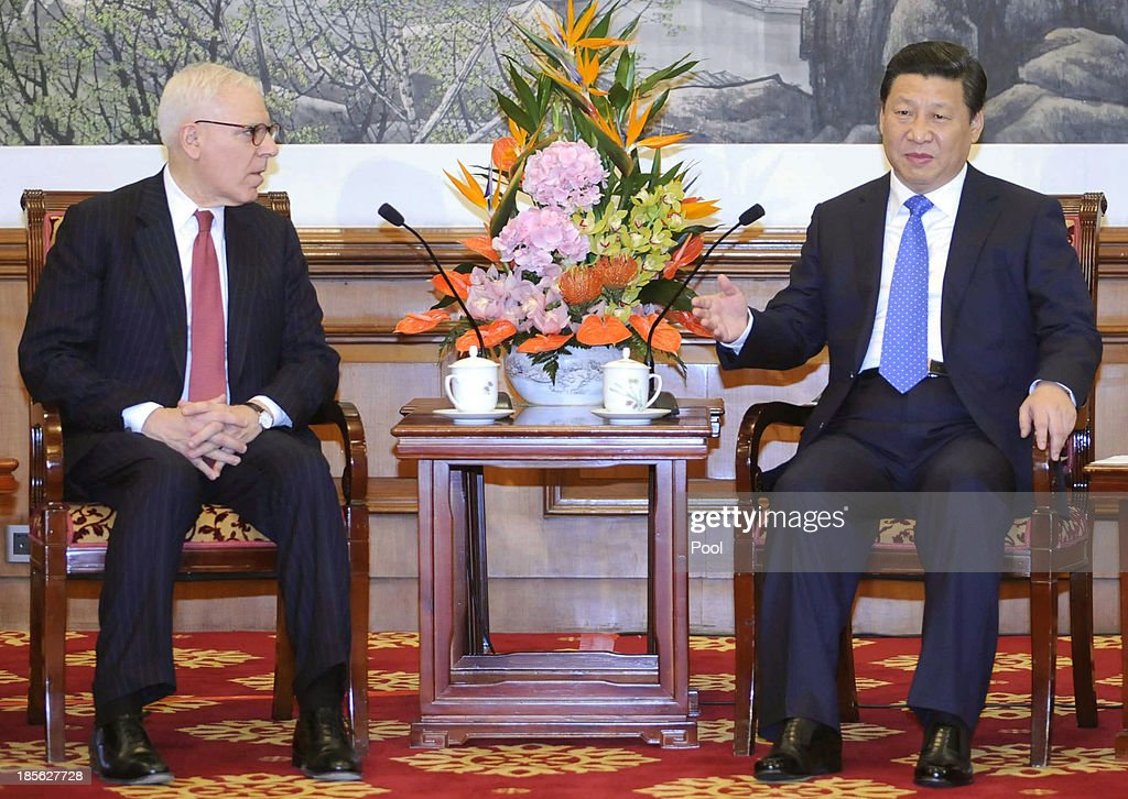 Chinese President Xi Jinping (R) talks with David Rubenstein, the Chair of advisory board as he meets with the advisory board entrepreneurs from Tsinghua School of Economics and Management at the Diaoyutai State Guesthouse on October 23, 2013 in Beijing, China.