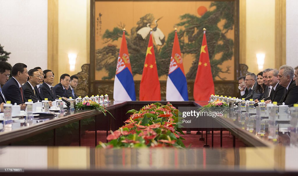 Chinese President Xi Jinping talks with Serbian President Tomislav Nicolic at the Great Hall of the People in Beijing 26 August 2013. Nicolic is on a five day visit to China to bolster economic and diplomatic ties.