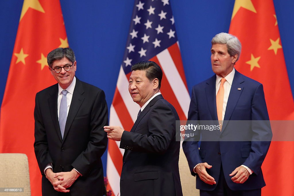 Chinese President <a gi-track='captionPersonalityLinkClicked' href=/galleries/search?phrase=Xi+Jinping&family=editorial&specificpeople=2598986 ng-click='$event.stopPropagation()'>Xi Jinping</a> (C), U.S. Secretary of State <a gi-track='captionPersonalityLinkClicked' href=/galleries/search?phrase=John+Kerry&family=editorial&specificpeople=154885 ng-click='$event.stopPropagation()'>John Kerry</a> (R) and U.S. Treasury Secretary <a gi-track='captionPersonalityLinkClicked' href=/galleries/search?phrase=Jack+Lew&family=editorial&specificpeople=2745013 ng-click='$event.stopPropagation()'>Jack Lew</a> (L) attend the opening ceremony of the 6th China-U.S. Security and Economic Dialogue and 5th round of China-U.S. High Level Consultation on People-to-People Exchange at Diaoyutai State Guest House on July 9, 2014 in Beijing, China.