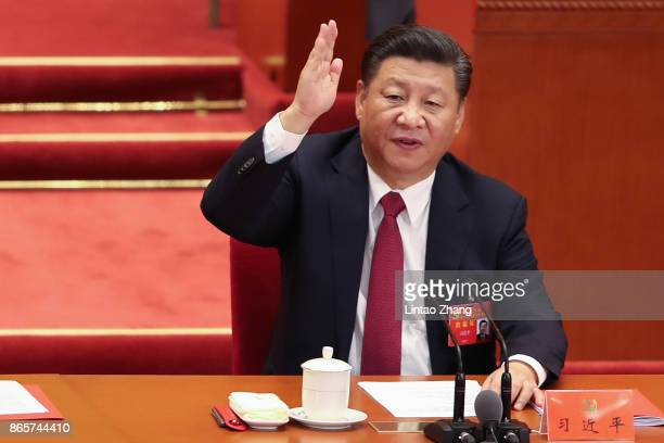 Chinese President Xi Jinping vote at the closing of the 19th Communist Party Congress at the Great Hall of the People on October 24 2017 in Beijing...