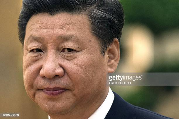 Chinese President Xi Jinping waits before meeting US National Security Advisor Susan Rice at the Great Hall of the People in Beijing on August 28...