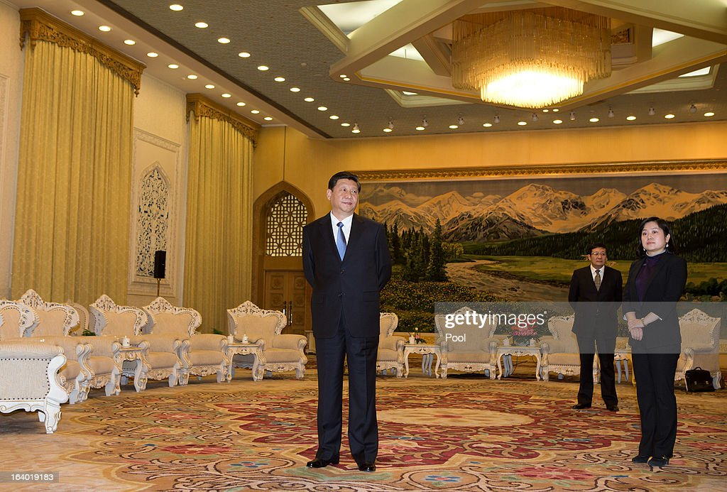 Chinese President Xi Jinping (C) waits to greet U.S. Secretary of Treasury Jacob Lew during his visit to the Great Hall of the People on March 19, 2013 in Beijing, China. Chinese leader Xi Jinping spoke of wanting strong ties with the U.S. after holding talks with the US Treasury secretary Jacob Lew today in his first meeting with a foreign official since being appointed as president.