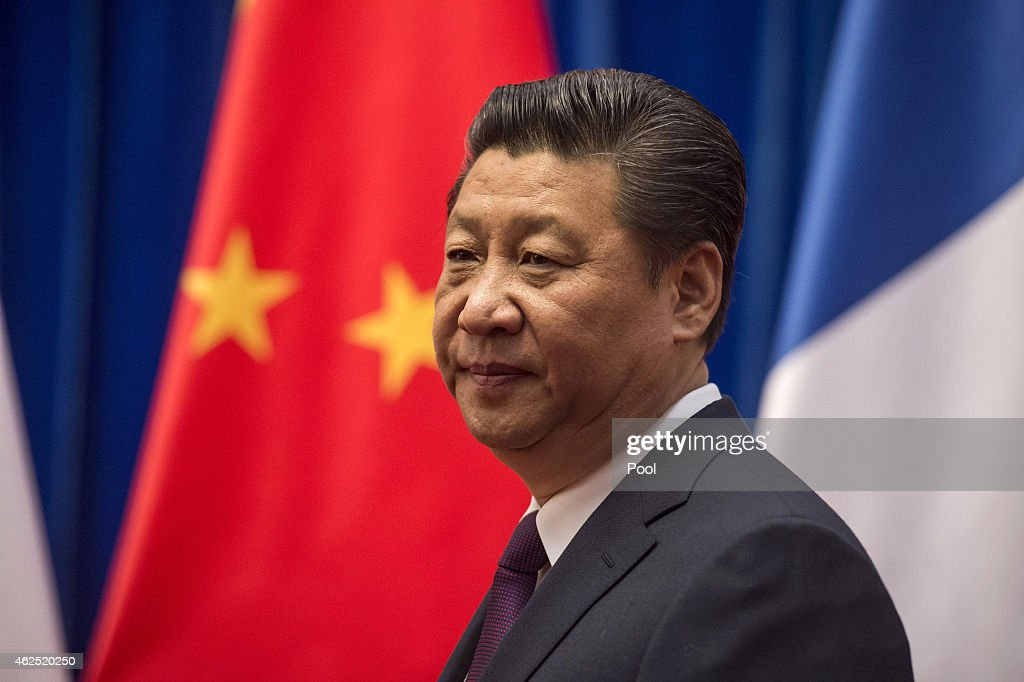 Chinese President <a gi-track='captionPersonalityLinkClicked' href=/galleries/search?phrase=Xi+Jinping&family=editorial&specificpeople=2598986 ng-click='$event.stopPropagation()'>Xi Jinping</a> waits to welcome French Prime Minister Manuel Valls at the Great Hall of the People on January 30, 2015 in Beijing, China. Valls is in China during the three-day trip.