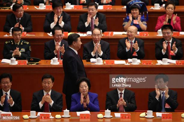 Chinese President Xi Jinping walks after delivering his speech during the opening session of the 19th Communist Party Congress held at the Great Hall...