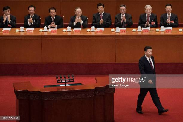 Chinese President Xi Jinping walks on the stage at the opening session of the 19th Communist Party Congress held at The Great Hall Of The People on...