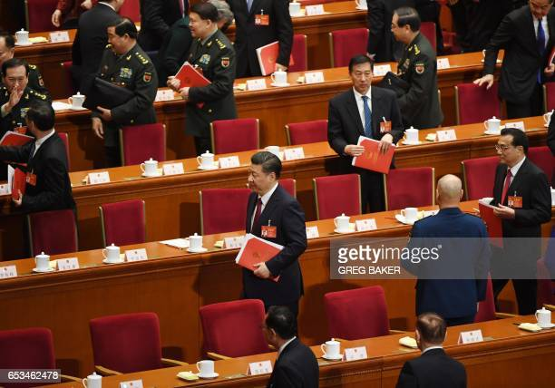 Chinese President Xi Jinping walks out after the closing session of the National People's Congress China's legislature at the Great Hall of the...
