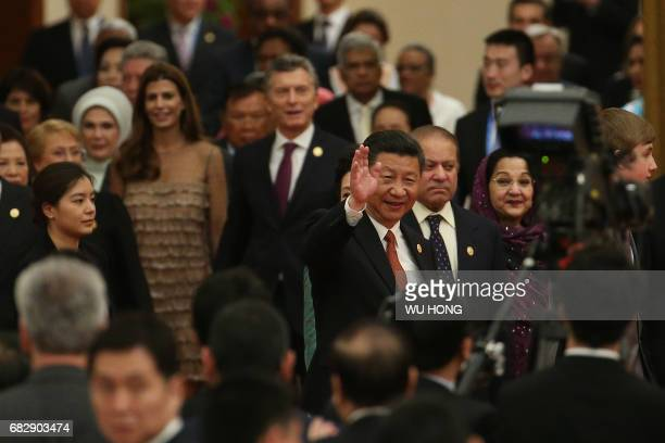 Chinese President Xi Jinping waves to guests as he arrives with other leaders for a welcome banquet for the Belt and Road Forum at the Great Hall of...