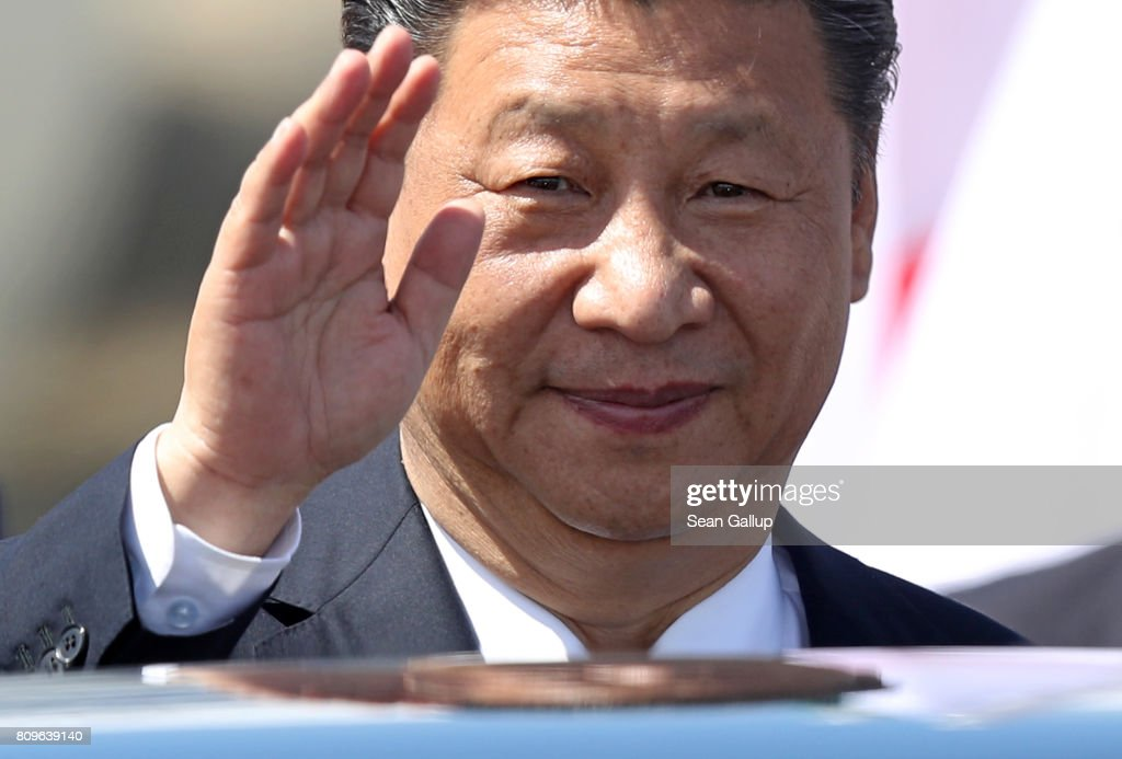 Chinese President Xi Jinping waves upon his arrival at Hamburg Airport for the Hamburg G20 economic summit on July 6, 2017 in Hamburg, Germany. Leaders of the G20 group of nations are meeting for the July 7-8 summit. Topics high on the agenda for the summit include climate policy and development programs for African economies.