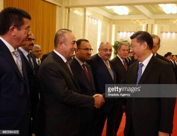 Chinese President Xi Jinping welcomes Chief of General Staff of Turkey Hulusi Akar Turkish Deputy PM Tugrul Turkes Turkish Economy Minister Nihat...