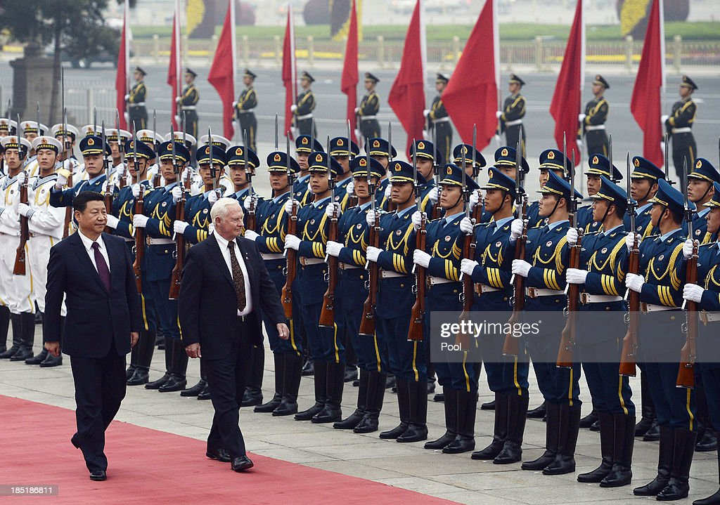 Chinese President <a gi-track='captionPersonalityLinkClicked' href=/galleries/search?phrase=Xi+Jinping&family=editorial&specificpeople=2598986 ng-click='$event.stopPropagation()'>Xi Jinping</a> (L) welcomes Governor General David Johnston of Canada at the Great Hall of the People on October 18, 2013 in Beijing, China.