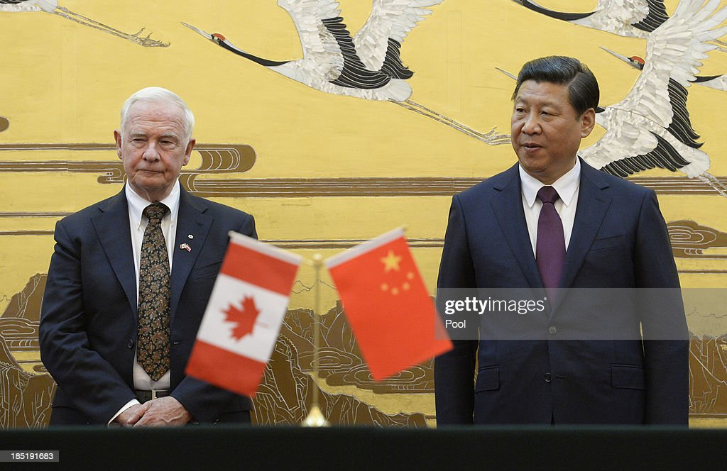 Chinese President <a gi-track='captionPersonalityLinkClicked' href=/galleries/search?phrase=Xi+Jinping&family=editorial&specificpeople=2598986 ng-click='$event.stopPropagation()'>Xi Jinping</a> (R) welcomes Governor General David Johnston of Canada at the Great Hall of the People on October 18, 2013 in Beijing, China.