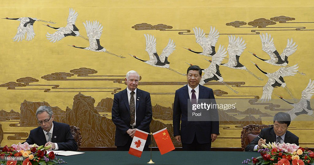 Chinese President Xi Jinping (2R) welcomes Governor General David Johnston of Canada at the Great Hall of the People on October 18, 2013 in Beijing, China.