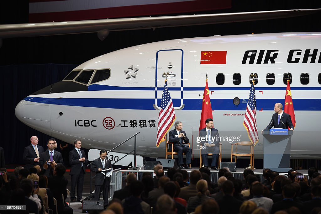 Chinese President Xi Jinping with Dennis Muilenburg President and CEO of the Boeing Company and Ray Conner President and CEO of the Boeing Commercial...