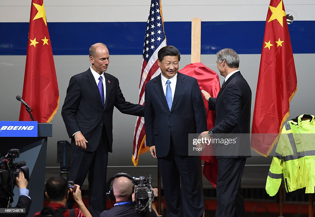 Chinese President Xi Jinping with Dennis Muilenburg who is the President and CEO of the Boeing Company and Ray Conner who is the President and CEO of...