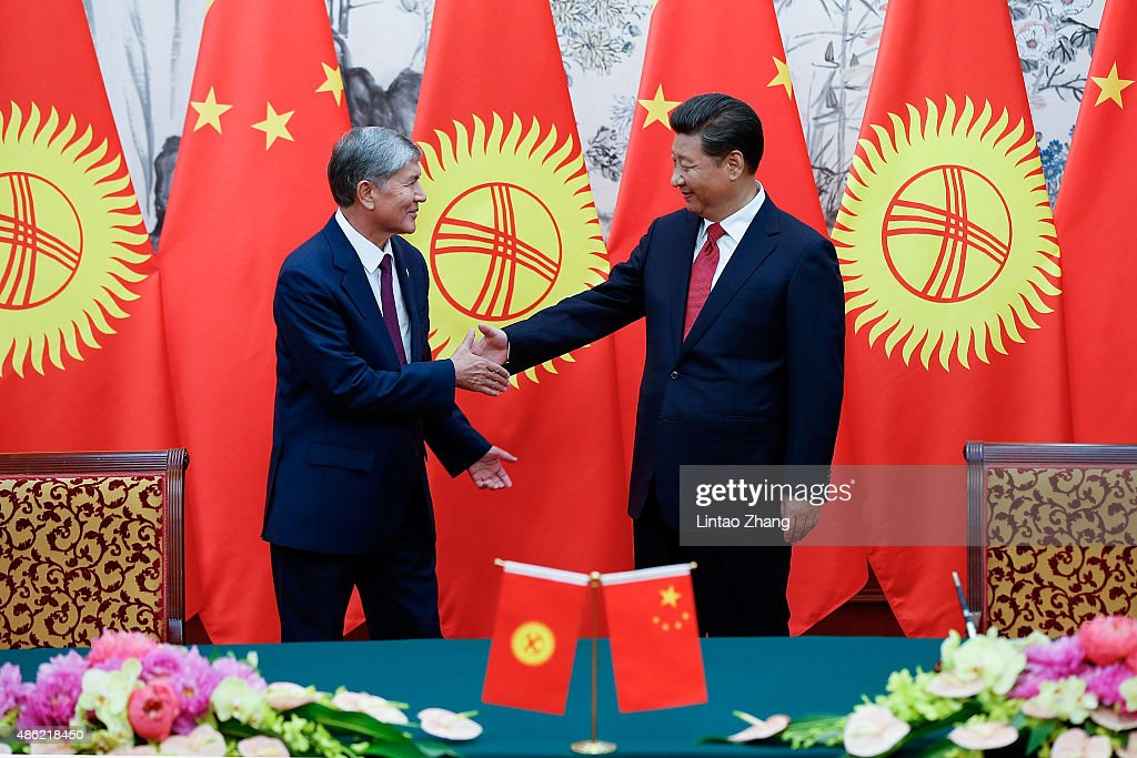 Chinese President Xi Jinping (R) with Kyrgyzstan's President Almazbek Atambayev (L) during the signing ceremony at Diaoyutai State Guesthouse on September 2, 2015 in Beijing, China. Almazbek Atambayev will attend the Chinese People's Anti-Japanese War and the World Anti-Fascist War 70th anniversary victory parade on September 3.