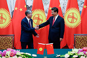 Chinese President Xi Jinping with Kyrgyzstan's President Almazbek Atambayev during the signing ceremony at Diaoyutai State Guesthouse on September 2...