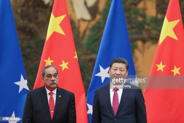 Chinese President Xi Jinping with Micronesia's President Peter Christian attend a signing ceremony at the Great Hall of the People on March 27 2017...