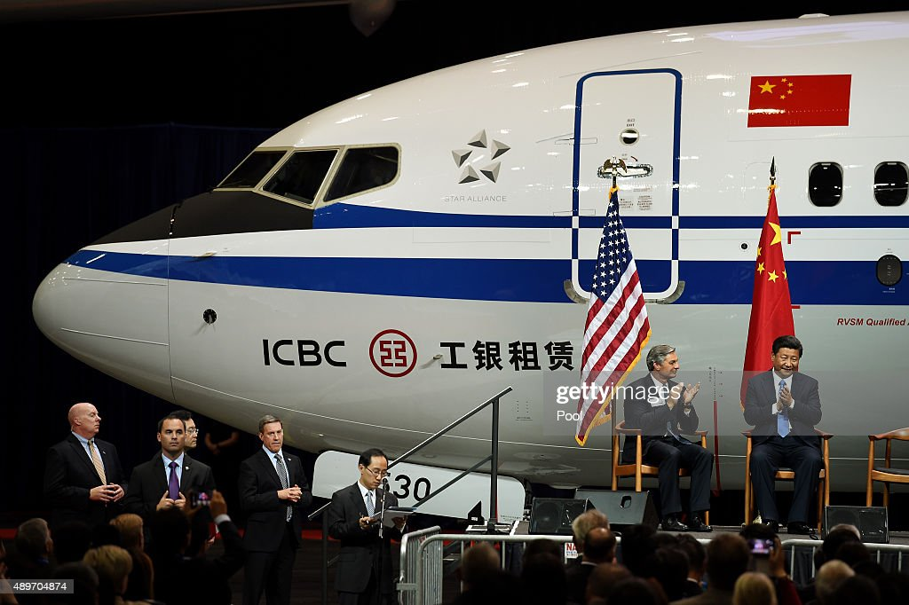 Chinese President Xi Jinping with Ray Conner President and CEO of the Boeing Commercial Airplanes sit on stage after his tour of the Boeing assembly...