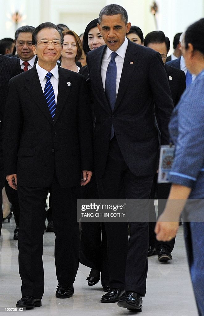 Chinese Prime Minister Wen Jiabao (L) and US President <a gi-track='captionPersonalityLinkClicked' href=/galleries/search?phrase=Barack+Obama&family=editorial&specificpeople=203260 ng-click='$event.stopPropagation()'>Barack Obama</a> (C) arrive at the Peace Palace in Phnom Penh on November 20, 2012. Obama was on November 20 set to defy Beijing's protests and use the summit to raise concerns over South China Sea rows that have sent diplomatic and trade shockwaves across the region. AFP PHOTO / TANG CHHIN SOTHY