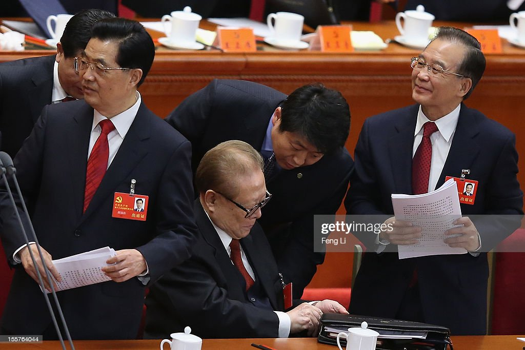 Chinese Prime Minister Wen Jiabao former Chinese President Jiang Zemin and Chinese President Hu Jintao leave after the opening session of the 18th...