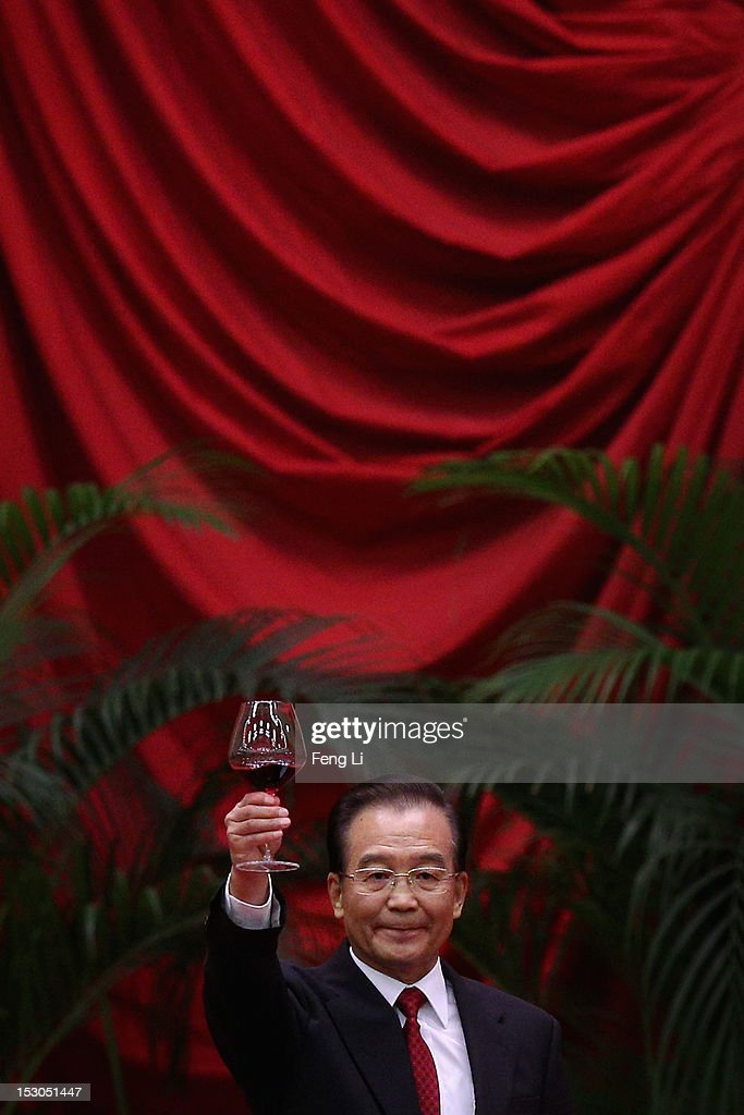Chinese Prime Minister <a gi-track='captionPersonalityLinkClicked' href=/galleries/search?phrase=Wen+Jiabao&family=editorial&specificpeople=204598 ng-click='$event.stopPropagation()'>Wen Jiabao</a> toasts the guests after delivering a speech during a banquet marking the 63th anniversary of the founding of the People's Republic of China on September 29, 2012 at the Great Hall of the People in Beijing, China. China must steadfastly advance institutional reforms in economic, political, cultural, social and other fields and stick to the opening-up policy, Premier <a gi-track='captionPersonalityLinkClicked' href=/galleries/search?phrase=Wen+Jiabao&family=editorial&specificpeople=204598 ng-click='$event.stopPropagation()'>Wen Jiabao</a> said on Saturday.