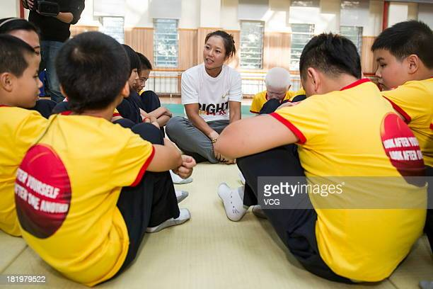 Chinese professional tennis player Li Na visits a school for the blind as the newest global Athlete Ambassador of Right To Play a global organization...