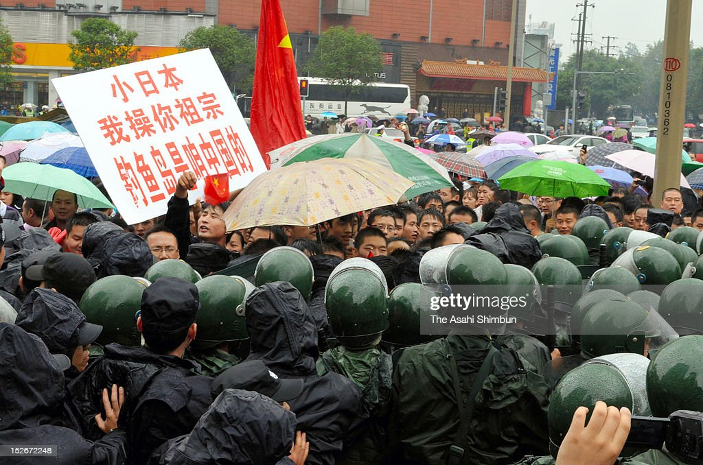 Chinese protestors are stopped by Chinese Paramilitary Police in front of the U.S. Consulate General on September 16, 2012 in Chengdu, China. There were protests in many major cities in China, including Shanghai, Shenzhen, Shenyang, Hangzhou, Harbin, Qingdao and Hong Kong as they oppose to the Japanese government's purchase of the disputed Senkaku/Diaoyu islands.