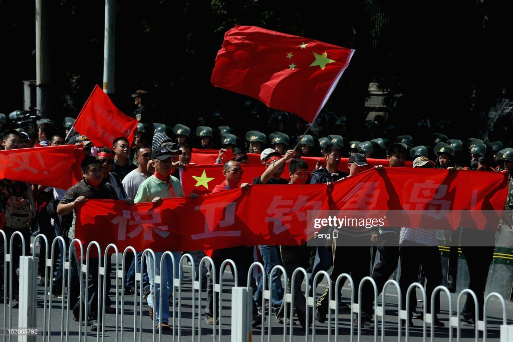 Chinese protestors stage an anti Japan rally outside the Japan Embassy on September 15, 2012 in Beijing, China. There were protests in many major cities in China, including Shanghai, Shenzhen, Shenyang, Hangzhou, Harbin, Qingdao and Hong Kong.