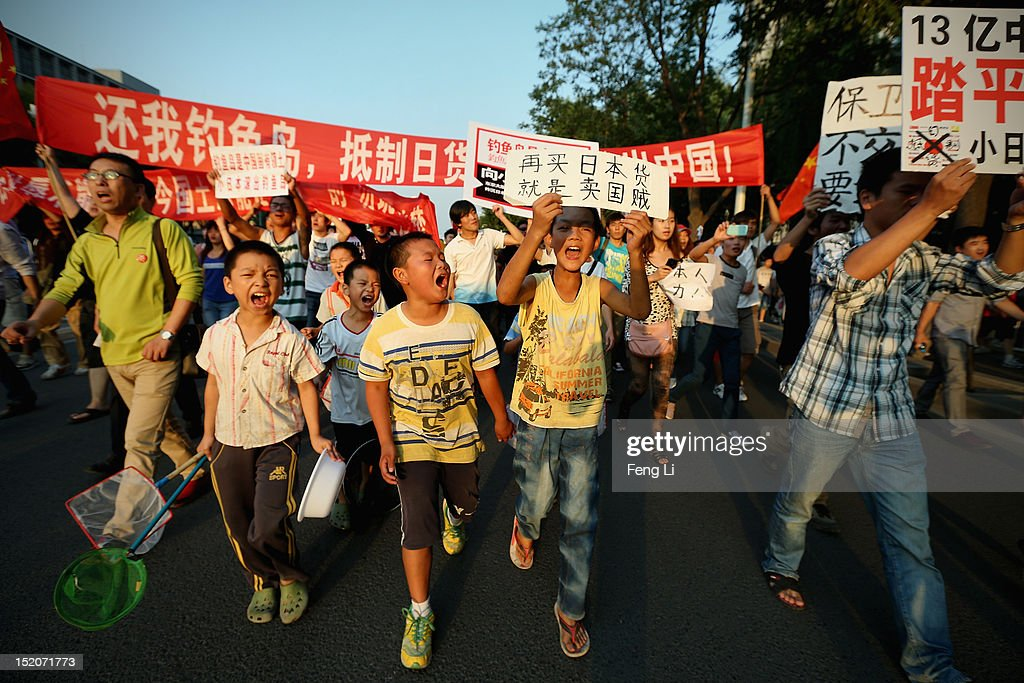 Chinese protestors stage an anti Japan rally outside the Japan Embassy on September 16, 2012 in Beijing, China. Protests have taken place across China in a dispute that is becoming increasingly worrying for regional stability.