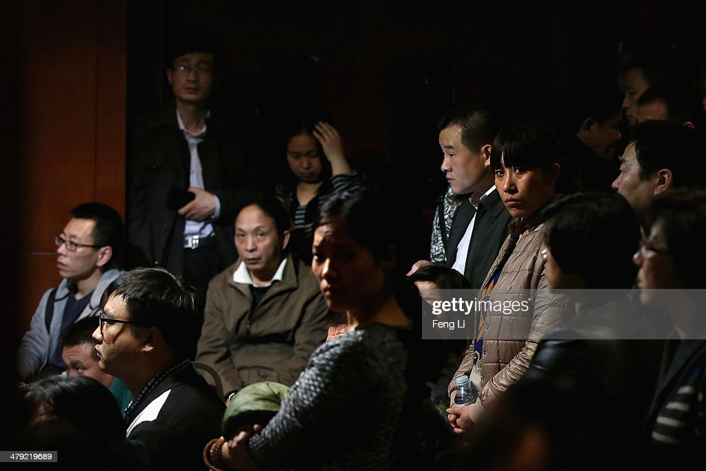 Chinese relatives of the missing passengers who were travelling onboard Malaysia Airlines flight MH370 watch a television displaying a Malaysian press conference at Lido Hotel on March 17, 2014 in Beijing, China. The search area for Malaysian Airlines flight MH370 has increased again to include both land and water from Kazakhstan to the southern Indian Ocean following reports the airliner flew for seven hours after last contact. The missing aircraft disappeared one week ago carrying 227 passengers and 12 crew on route from Kuala Lumpur to Beijing. All passengers and crew are currently under investigation and 22 countries are involved in the search.