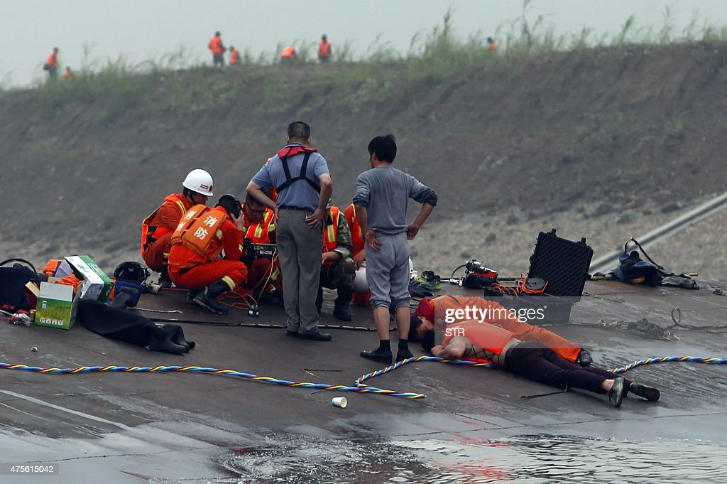 Chinese rescue workers use listening devices to detect survivors inside the capsized Dongfangzhixing or 'Eastern Star' vessel which sank in the...
