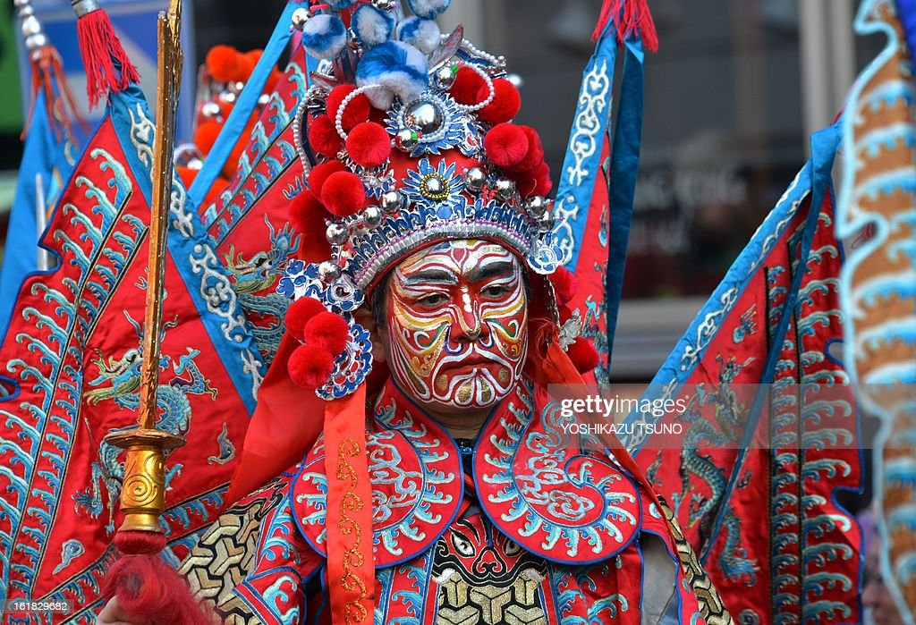 A Chinese resident in Japan wears costume of a Chinese ancient warrior to celebrate the Lunar New Year in Japan's largest Chinatown in Yokohama, suburban Tokyo on February 17, 2013. Tens of thousands people enjoyed the annual parade event to mark the start of the Lunar New Year. AFP PHOTO / Yoshikazu TSUNO Tens of thousands people enjoyed the annual parade event to mark the start of the Lunar New Year. AFP PHOTO / Yoshikazu TSUNO