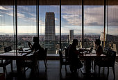Chinese restaurant patrons dine in a luxury hotel overlooking the skyline of the Central Business District on June 11 2015 in Beijing China The area...