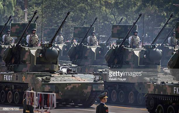 Chinese ride in armoured vehicles as they drive towards Tiananmen Square and the Forbidden City during a military parade on September 3 2015 in...