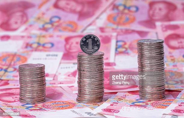Chinese RMB banknotes and coins are arranged for a photograph After a fivemonth slide the Renminbi seems to be coming back and China is encouraging...