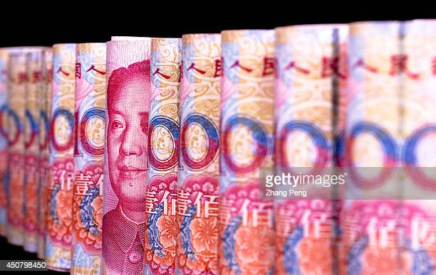 Chinese RMB banknotes are arranged for a photograph After a fivemonth slide the Renminbi seems to be coming back and China is encouraging RMB and...