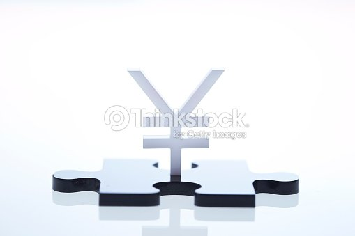 Chinese Rmb Japanese Yen Currency Symbol And Puzzle Piece Stock