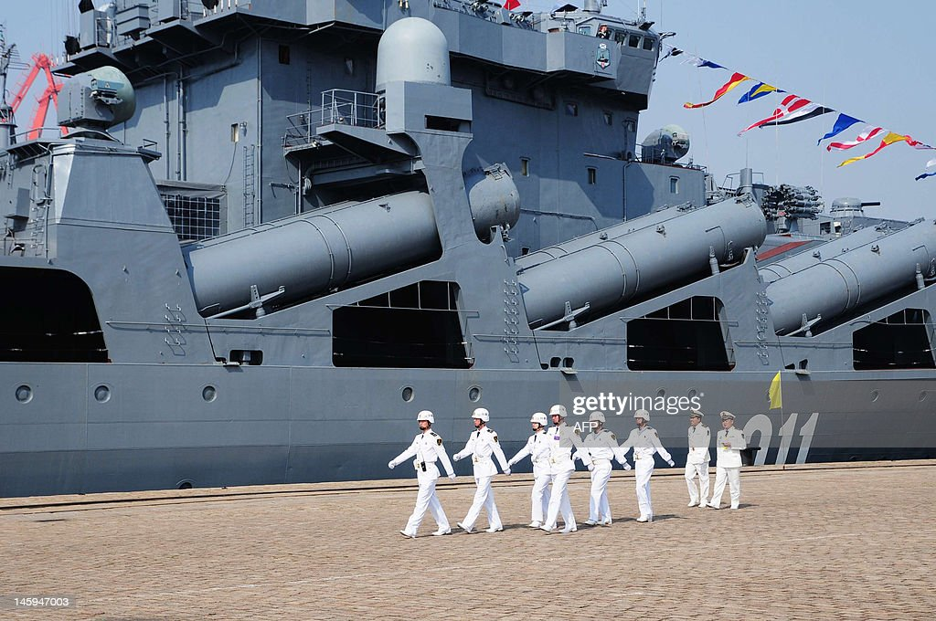 Chinese sailors march pass the Russian destroyer Admiral Vinogradov berthed at the People's Liberation Army (PLA) naval base in Qingdao, northeastern China's Shandong province on April 23, 2012, prior to the start of the Sino-Russian joint naval exercises. China and Russia launched their first joint naval exercises, with war games in the Yellow Sea that come amid tensions between China and its Asian neighbours over territorial claims. CHINA